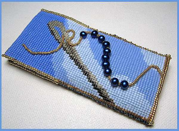 Side one of blue needle case
