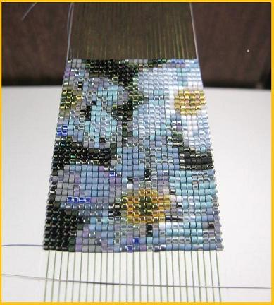 The bead colors shine with a white weft!