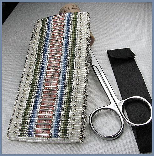 Side one of needle case
