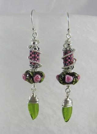 lampwork and seeds with a glass leaf dangle