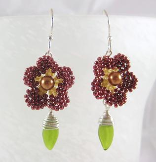 Red permanent Toho seed bead flowers with glass leaf dangle